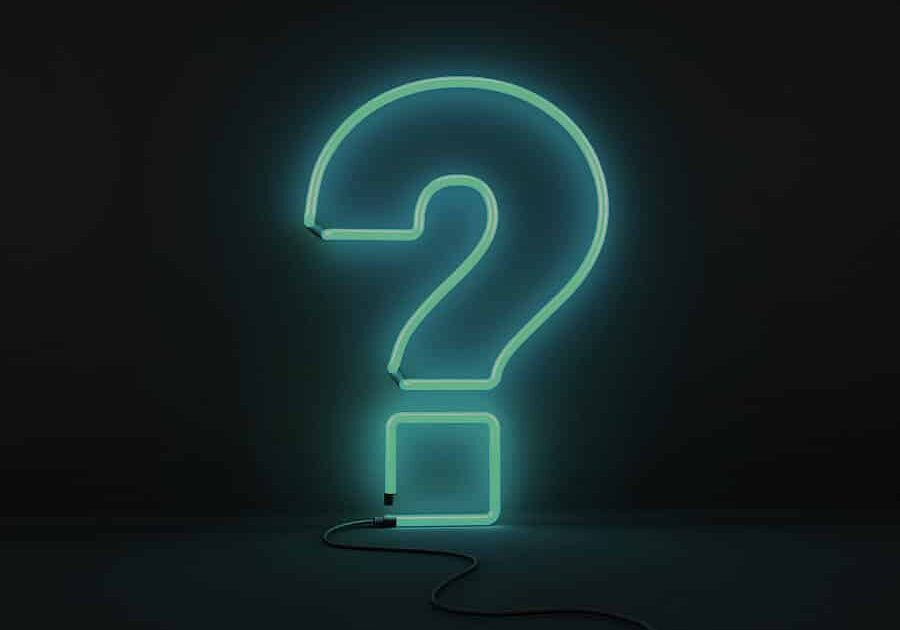 blue ethic advertising agency neon question mark on black background